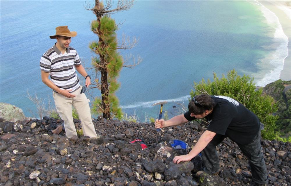 Dr Russel Bailie and Brett Burgell examining Manganese samples on one of the many dumps.