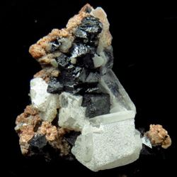 Picture of Hausmanite on Andradite with Calcite. (Kalahari Manganese Fields, South Africa)