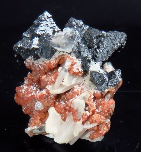 Picture of Hausmanite on Andradite with Barite . (Kalahari Manganese Fields, South Africa)