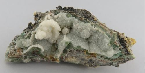 Picture of Calcite on Cuprite (Tsumeb, Namibia)